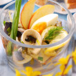 Herring salad in glass bowl for easter - Stock Photo