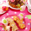Easter table with cookies and ring cake - Stock Photo