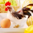 Easter table  with cock - Stock Photo