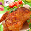 Baked whole chicken - Stock Photo