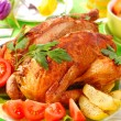 Roasted chicken stuffed with liver - Stock Photo