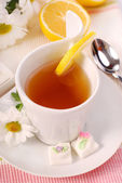 Tea with chamomile and lemons — Stock Photo
