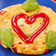 Omelette with sausage and red paprika - Stock Photo