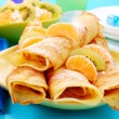 Stock Photo: Pancakes with orange and kiwi