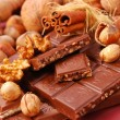 Stock Photo: Chocolate bars with nuts and raisins