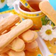 Sponge fingers and tea for child — Stock Photo