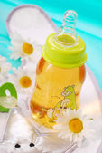 Bottle of camomile tea — Stock Photo