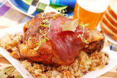 Pork knuckle baked with beer — Stok fotoğraf