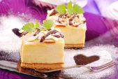 Cheese cake on purple plate — Stock Photo