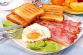 Bacon and eggs for breakfast — Stock Photo