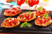Bruschetta toasted on electric grill — Stock Photo