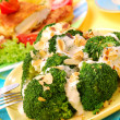 Broccoli with garlic sauce and almonds — Stock Photo