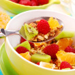 Stock Photo: Muesli with fresh fruits as diet food