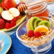 Muesli with  fruits as diet breakfast - Stock Photo