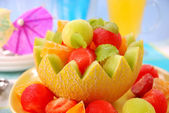 Fruits salad in melon bowl — Stock Photo