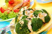 Broccoli with garlic sauce and almonds — Stock Photo