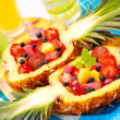 Fruits salad in pineapple - Stock Photo