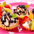 Mini tartlets with cream and fruits — Stock Photo