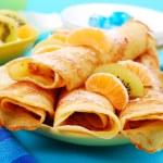 Pancakes with orange and kiwi — Stock Photo
