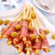 Prosciutto with grissini — Stock Photo