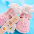 Baby shoes for girl and pregnancy test — Stock Photo