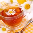Camomile tea in glass — Stock Photo