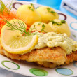 Breaded fish for dinner - Stock Photo