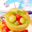 Fruit salad in melon — Stock Photo