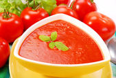 Tomato cream soup with basil — Stock Photo