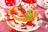 Pancakes with strawberry and cream — Stock Photo