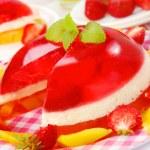 Strawberry and mango jelly with cream — Stock Photo
