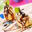 Stock Photo: Pears with flaked almonds and chocolate