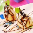 Pears with flaked almonds and chocolate — Stock Photo