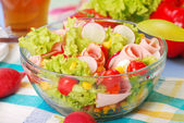 Fresh salad with ham — Stock Photo