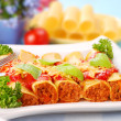 Cannelloni stuffed with minced meat - Stock Photo