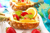 Fruit salad in pineapple — Stock Photo