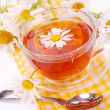 Camomile tea in glass - Stock Photo