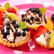 Stock Photo: Mini tartlets with cream and fruits