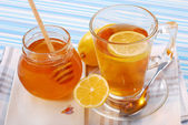 Tea with lemon and honey — Stock Photo