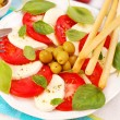 Stock Photo: Caprese salad with grissini