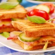 Toasts with cheese,bacon and tomato - Stock Photo