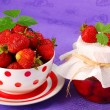 Stock Photo: Strawberry preserves and bowl of fresh fruits