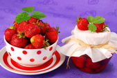 Strawberry preserves and bowl of fresh fruits — Stock Photo