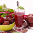 Fresh beets with leaves and clear soup - Stock Photo