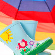 Stock Photo: Children`s wellington boots and umbrella