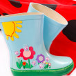Children`s wellington boots and umbrella — Stock Photo