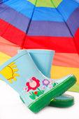 Children`s wellington boots and umbrella — Stock Photo