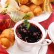 Stock Photo: Red borscht and yeast pastries for christmas