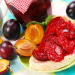 Sweet bun with plum confiture - Stock Photo
