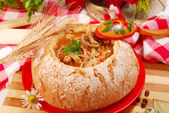 Polish tripe soup (flaki) in bread bowl — Stock Photo